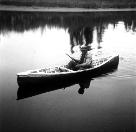 Al Starr in ratting canoe, photo by Robert Dick - click here